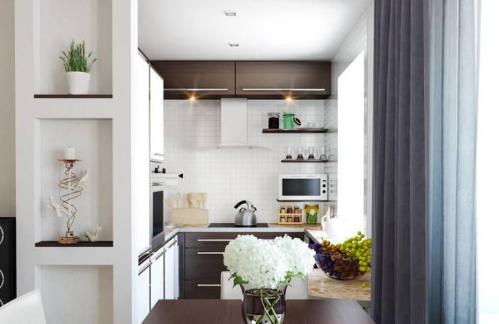 Кухня в светлых тонах, выполненная в современном стиле.