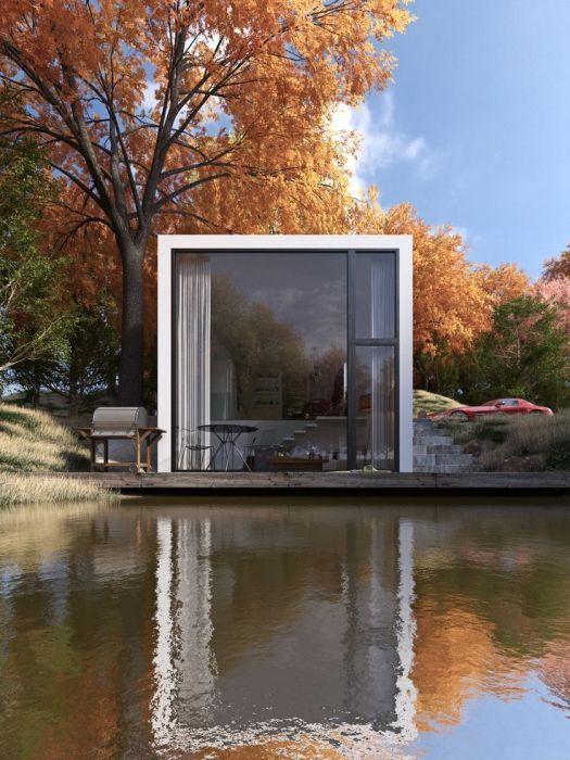 Гармоничное сочетание дома хай-тек и осеннего пейзажа.