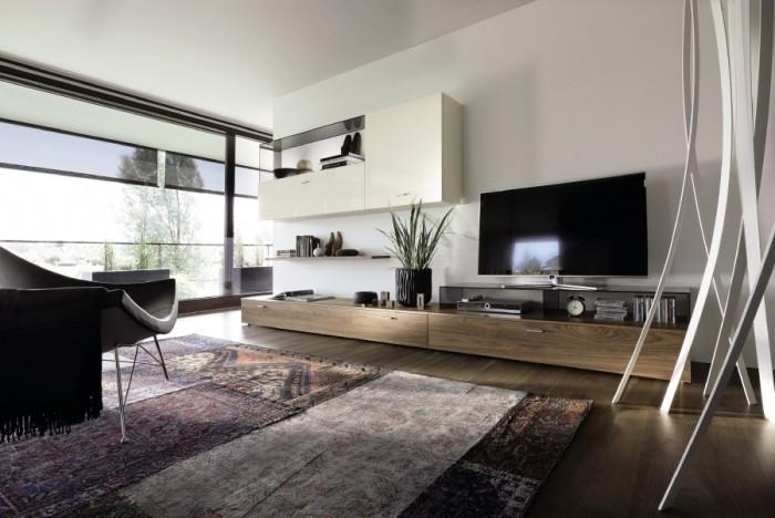 Диван, несколько кресел и подставка под телевизор - идеально дополнят гостиную.
