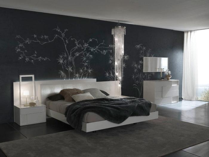 Если правильно подобрать мебель и напольное покрытие, то даже в маленькой спальне чёрные обои будут смотреться прекрасно.