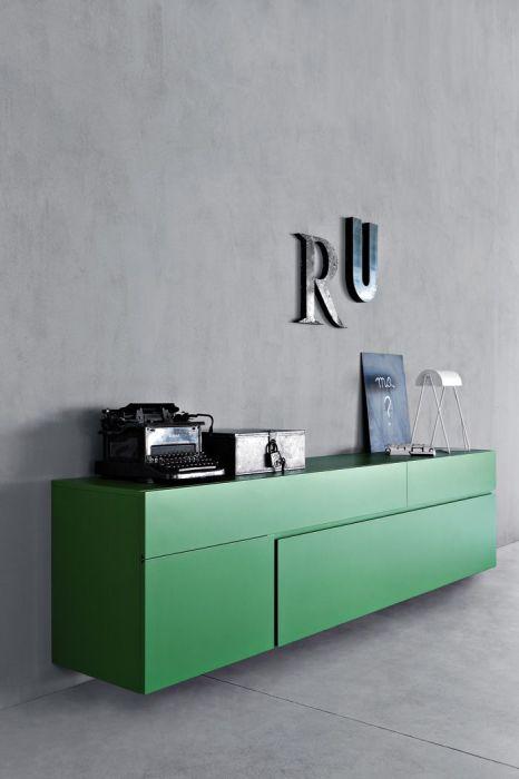 Серые гранитовые стены и нефритовая мебель выглядят стильно.