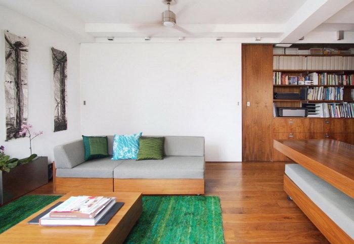 Современный дизайн гостиной. выполненный в нефритовых тонах.