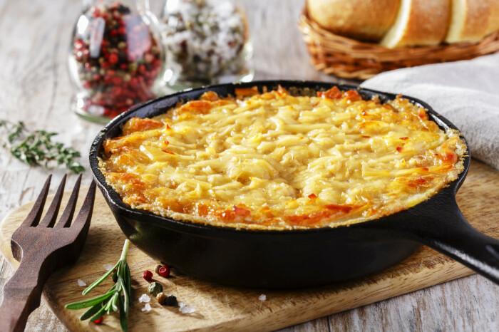 Картофельная запеканка с квашеной капустой и яблоками. \ Фото: blog.nutritienda.com.