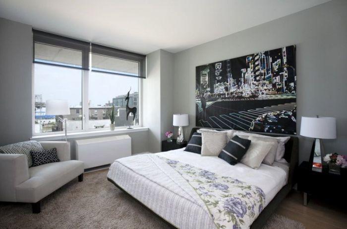 Серые стены в интерьере спальни.
