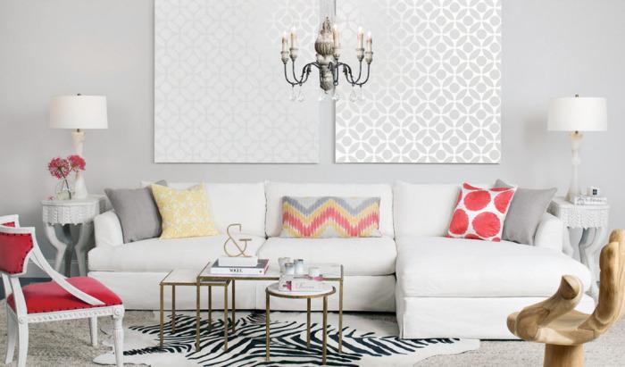 Ко всему прочему серые стены отлично смотрятся с элементами красного, будь то декоративные подушки или мебель.