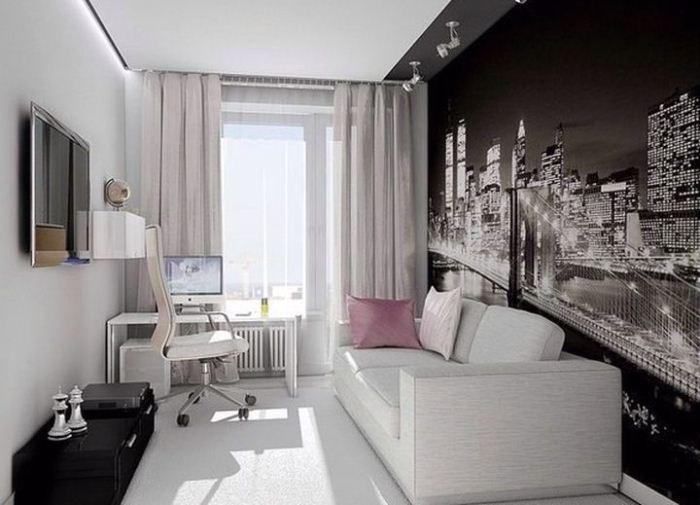 Светлые стены и контрастные фотообои с подсветкой - хорошее решение для узкой комнаты.