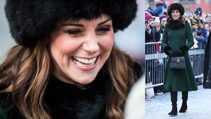 Кейт Миддлтон в пальто бутылочного цвета и меховой шапке.
