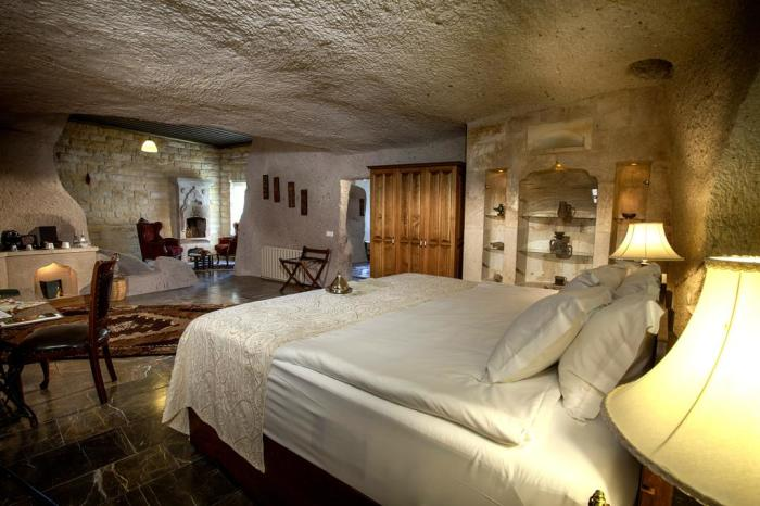 Интерьер номеров Museum Hotel Cappadocia погружает в прошлые эпохи. /Фото: cf.bstatic.com