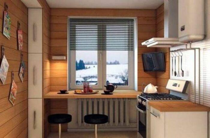 Подоконник как барная стойка – удачное решение для малогабаритных кухонь. /Фото: bizweb.dktcdn.net