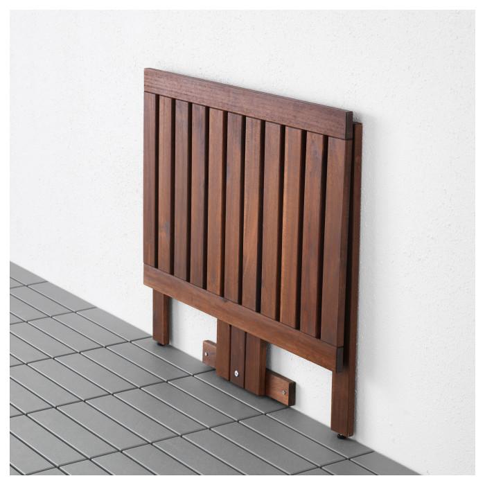 В сложенном виде откидной столик занимает минимум места. /Фото: dekormyhome.ru
