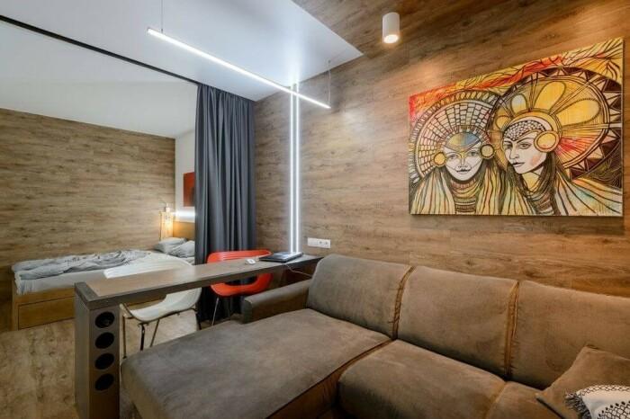 Шторы разделили комнату на две зоны и органично вписались в интерьер. /Фото: decoratw.com
