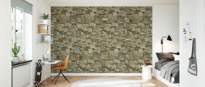 Каменная стена звучит выразительным акцентом в минималистическом дизайне комнаты. /Фото: images.photowall.com