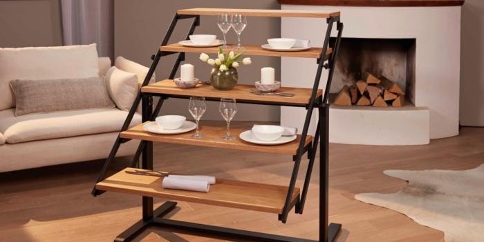 Конструкция в среднем положении: продвинуть вверх – преобразится в стеллаж, вниз – станет столом. /Фото: hips.hearstapps.com