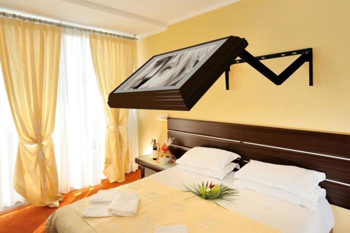 Кронштейны Hidden Vision позволяют вписать телевизор в интерьер так, чтобы он был незаметен. /Фото: gadgetsliving.com