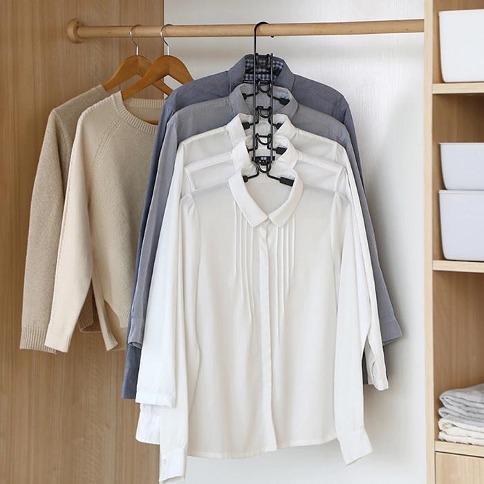 Многоуровневые вешалки значительно экономят полезное пространство в шкафу. /Фото: ae01.alicdn.com
