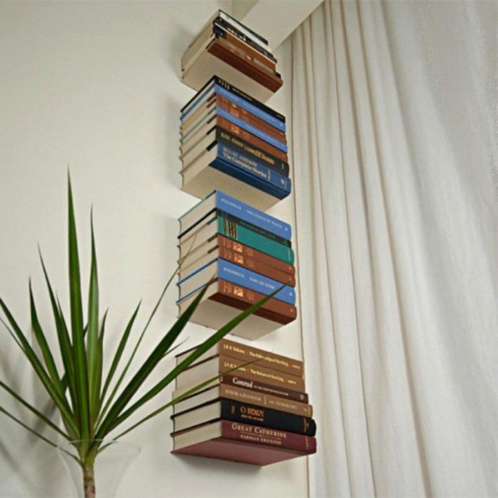 Большое количество книг может выглядеть эстетично и необычно, если постараться. /Фото: spirossoulis.com