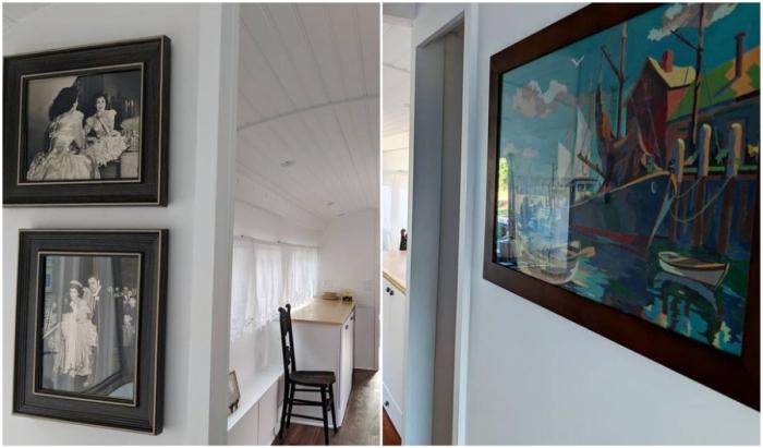 Семейные фотографии и красочные картины стали главным украшением интерьера.