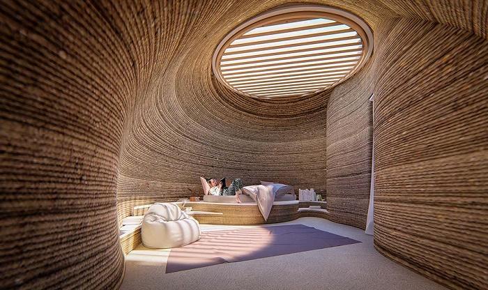 Интерьер спальни в доме, созданном из глины при помощи передовых технологий и 3D-принтера Crane WASP (TECLA, Италия). | Фото: atlasofthefuture.org.