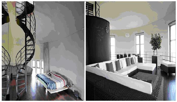 Винтовая лестница и огромное количество окон придает особенный шарм интерьеру.