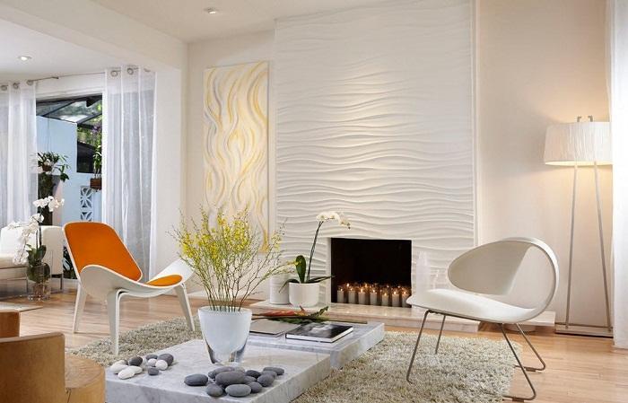 Белая рельефная стена очень эффектно смотрится в интерьере любой комнаты.