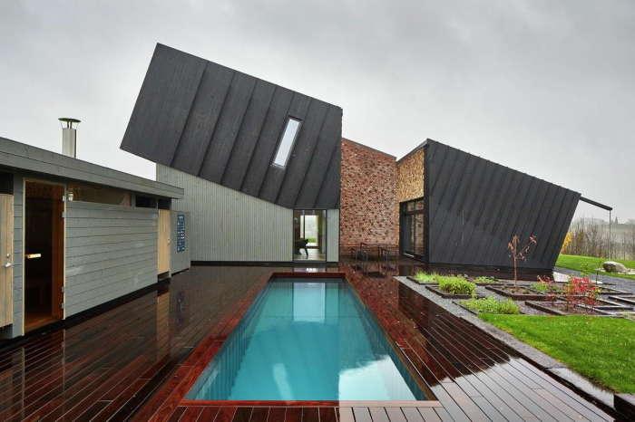 Уникальная архитектурная форма дома обеспечила высокой теплозащитой и энергоэффективностью  (Дом-электростанция, Норвегия). | Фото: supercoolpics.com.