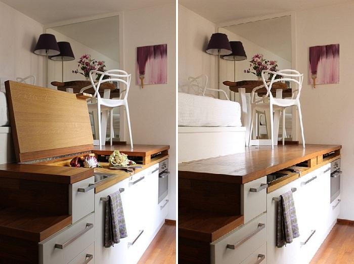 Чудесным образом кухня превратилась в столовую, благодаря откидным крышкам, которые одновременно служат полом для стола и стульев.