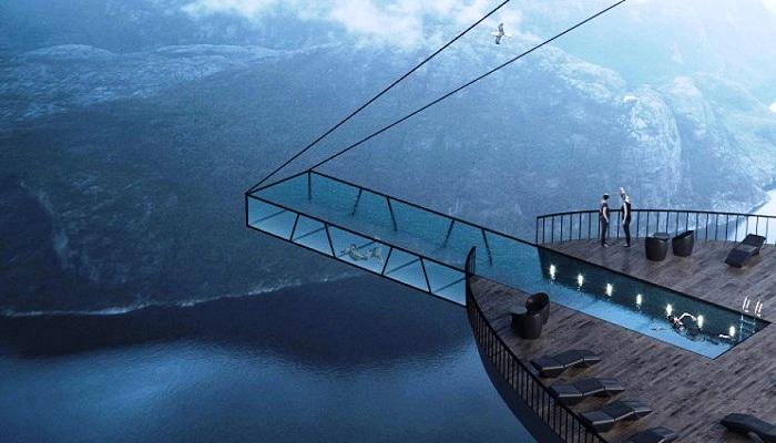 На нижнем уровне спроектировали длинный, узкий бассейн, выступающий из скалы, и зона отдыха (концепт Norwegian Cliff Hotel). | Фото: kordon.org.ua.