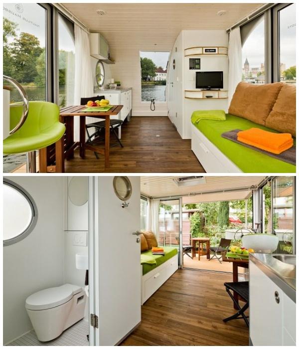Панорамные окна помогли создать иллюзию большего пространства (Плавучий дом Nautilus Mini, Германия).