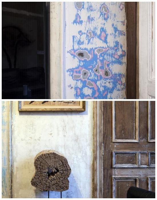 Оставленные нетронутыми стены и винтажные некрашеные двери сохранили несколько слоев старой краски.