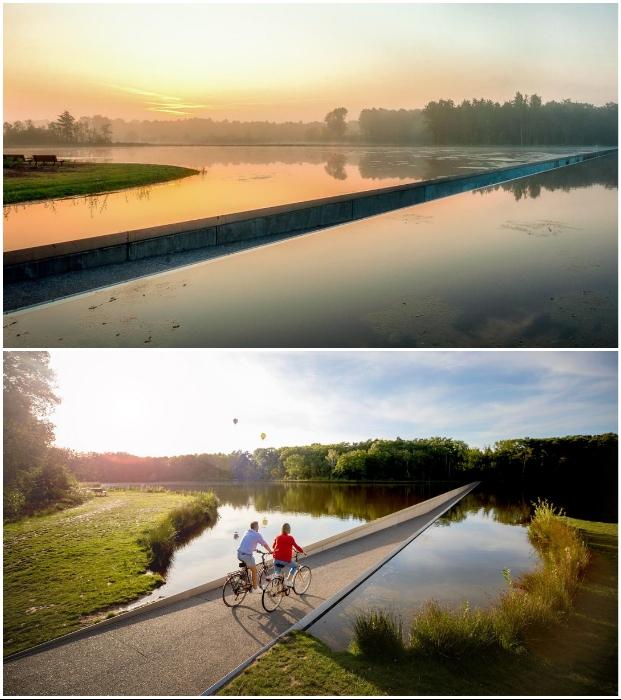 Путешествие по мосту, разрезающему водную гладь пруда, станет незабываемым приключением (Борглун, Бельгия). | Фото: visitlimburg.be/ dewereldvankaat.be.