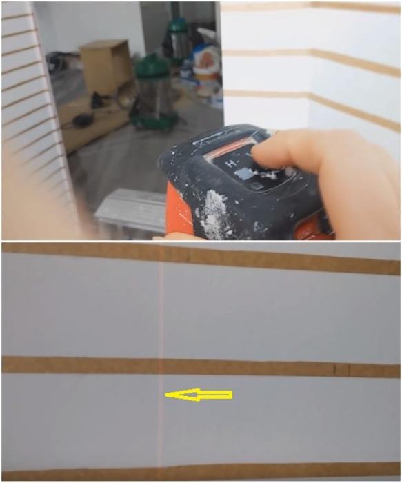 Для нанесения разметки на стену понадобится лазерный уровень. | Фото: youtube.com/ Анастасия Зайцева.