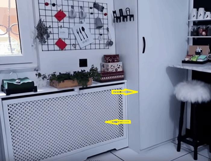 Водонагреватель закрыли шкафом, в котором организовали дополнительные места хранения, а радиатор спрятали за решеткой. | Фото:  youtube.com.