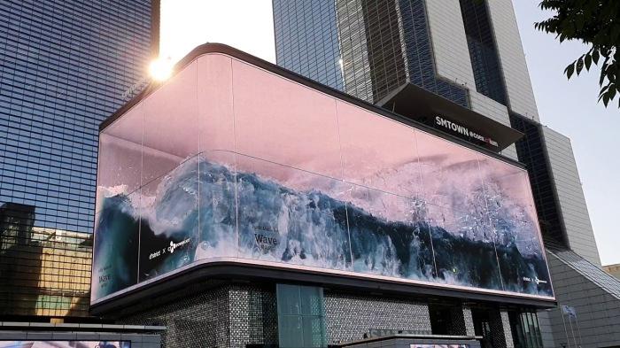 В Сеуле появилась реалистичная 3D иллюзия с набегающей океанской волной, стремящейся вырваться наружу («WAVE»).   Фото: profile-stalker.to.