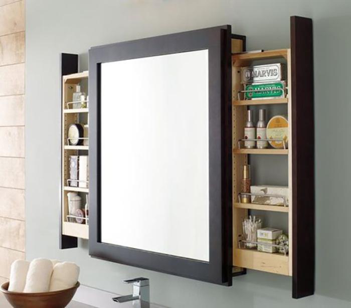 За зеркальным фасадом навесного шкафа легко можно спрятать скрытую систему хранения. | Фото: takprosto.cc.