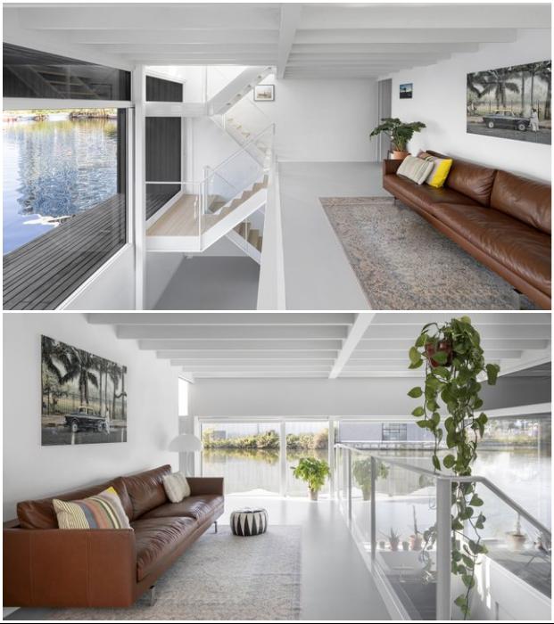 Одна из гостиных расположена между первым и вторым уровнями (Schoonschip, Нидерланды).