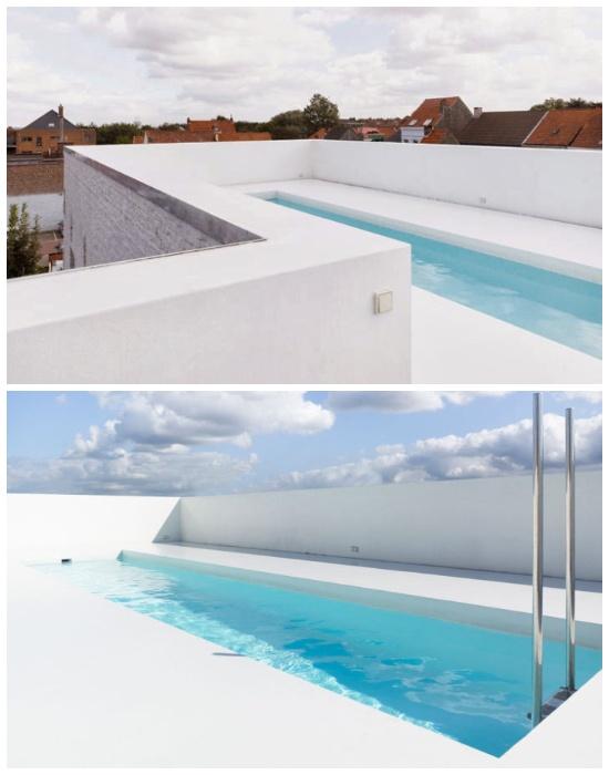 Белоснежный бассейн на крыше старинного здания (Гримберген, Бельгия).