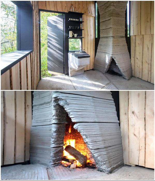 Живой огонь и чашечка горячего чая сделают отдых на опушке более душевным (Ashen Cabin, Итака). | Фото: dezeen.com.