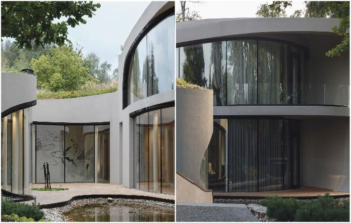 Панорамные окна выходят во внутренний двор, поэтому любопытствующих глаз можно не опасаться («House in the landscape», Подмосковье). | Фото: earquitecturaydiseno.es/ design-mate.ru.
