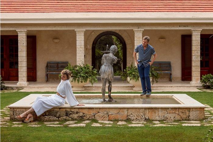 Уютный внутренний дворик, оформленный в итальянском стиле с фонтаном-статуей в центре.   Фото: Тьяго Молинос (Tiago Molinos).