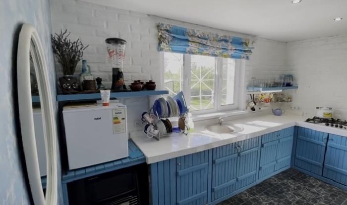 Оригинальная кухня из вторсырья и остатков материалов вот уже 7 лет радует мастера и домочадцев.   Фото: © GOODMASTER.