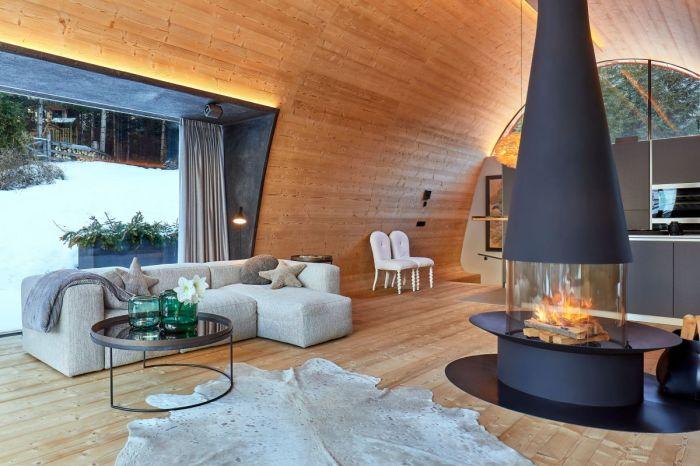 Дровяной камин не просто согреет в зимнюю стужу, но и создаст особую романтическую обстановку (курорт La Villa, Mi Chalet). | Фото: homedit.com/ © Luca Visciani.