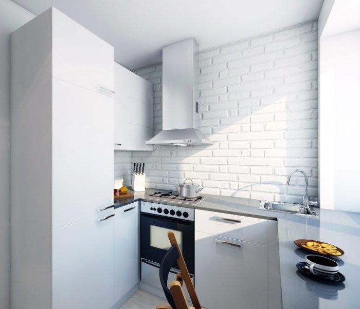 Монохромный интерьер кухни, выполненный в белом цвете. | Фото: dizajnroom.ru.