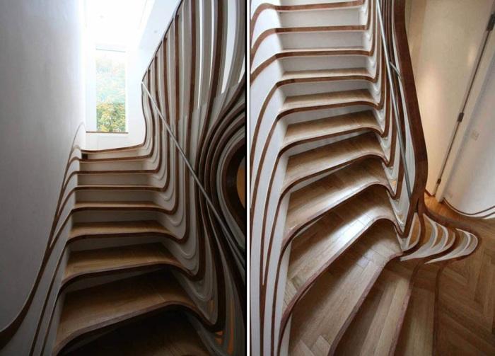 Деревянные края каждой ступени понимаются вверх и сливаются с поручнем, образовывая необычные плавные линии (Проект Atmos Studio). | Фото: atmosstudio.com.