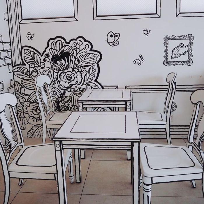 Использование двух цветов при оформлении мебели позволило создать иллюзию нарисованных предметов («2D Cafe», Токио). boredpanda.com.