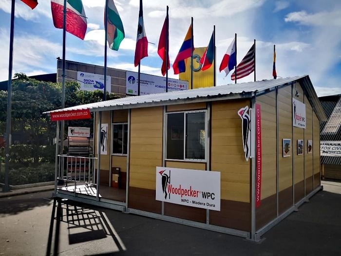 Композитный материал, позволяющий из отходов создавать надежные дома (WPC). | Фото: woodpecker.com.co.