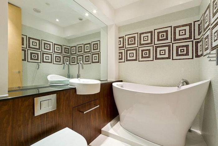 Грамотный дизайн способен визуально увеличить площадь ванной комнаты.