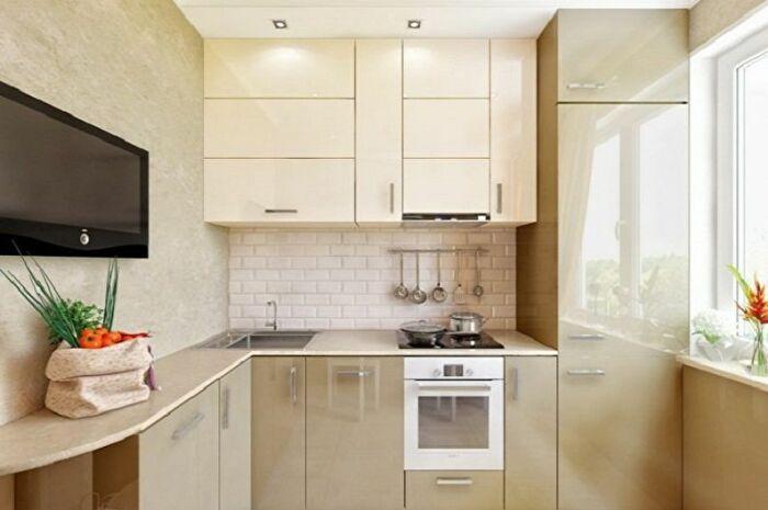Пудровые тона на кухне довольно выигрышно смотрятся. | Фото: trizio.ru.