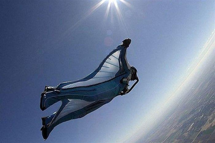 Полёт с вершины горы. /Фото: bigpicture.ru