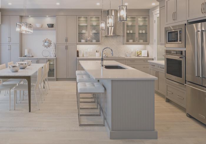 Барная стойка - практичное решение для современной кухни / Фото: ayakitchengallery.ca