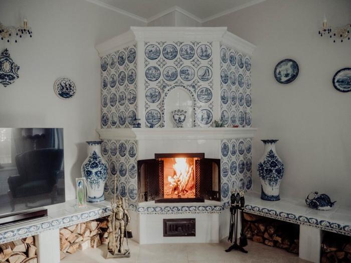 В России раньше помещение отапливали печью, которую устанавливали в углу комнаты / Фото: pechki-best.ru